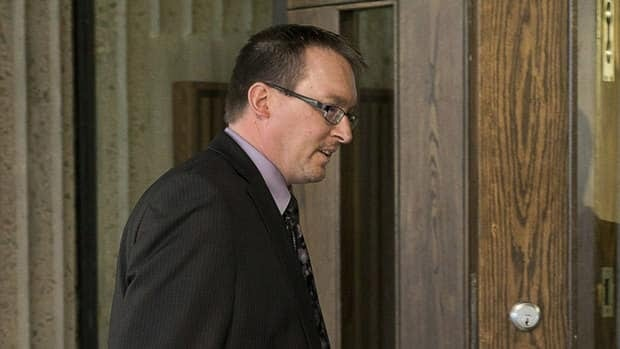 Lawyer Lyle Howe holds the door as his client, former MLA Trevor Zinck, heads into Nova Scotia Supreme Court in Halifax on Monday, June 17, 2013. Zinck was one of four politicians charged following an investigation by the province's auditor general into constituency allowance spending.