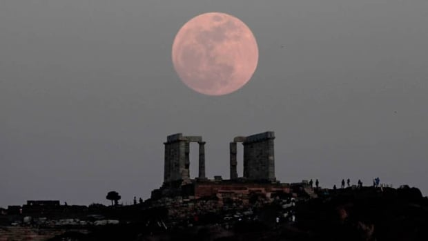 Last year's supermoon, shown rising behind the Temple of Poseidon in Cape Sounion, Greece, took place on May 5.