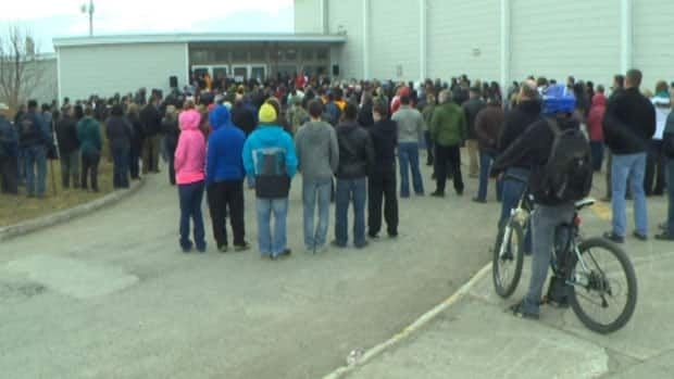 Protestors gather outside the West Coast Training Centre in Stephenville on Thursday.