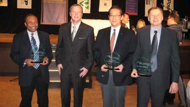 Premier Brad Wall, in the striped suit, with three people who became directors of Gen Five (l to r) Raphael Idem, Paitoon Tontiwachwuthikul and Don Gelowitz after the three University of Regina employees were given an award for their carbon capture research on April 7, 2008.