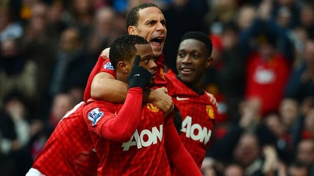 Manchester United's French defender Patrice Evra, left, celebrates United's second goal with teammate and English defender Rio Ferdinand, centre, as well as English striker Danny Welbeck during the English Premier League football match against Liverpool on Sunday.