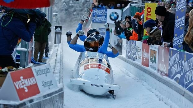 Team of Russia Alexander Zubkov, Alexey Negodaylo, Dmitry Trunenkov and Maxim Mokrousov celebrate their run in the FIBT Bobsleigh & Skeleton World Cup on Sunday in Koenigssee, Germany. The team went on to win the event.