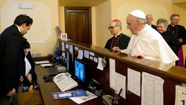 Pope Francis pays the bill at the Domus Sanctae Martae, where he stayed during the papal conclave, on March 14. Francis is still staying at the hotel, even though the official papal residence has been readied for him.