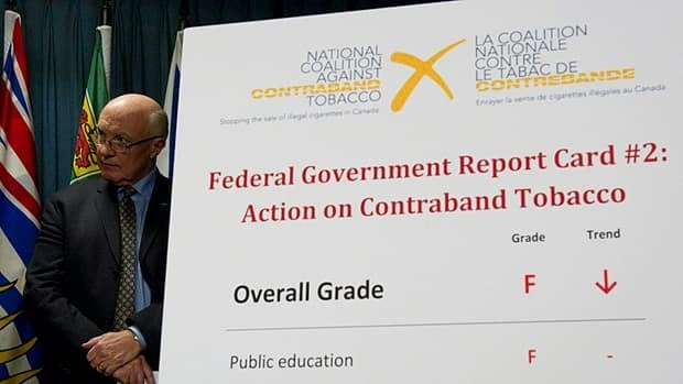 National Coalition Against Contraband Tobacco spokesman Gary Grant critiques the Harper government's record on battling the spread of contraband tobacco during a news conference on Parliament Hill Tuesday.