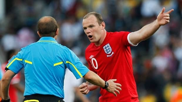 England's Wayne Rooney, right, questions assistant referee Pablo Fandino after Frank Lampard's controversial non-goal in South Africa in 2010.