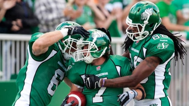 Saskatchewan Roughriders wide receiver Rob Bagg, left to right, slotback Weston Dressler, and wide receiver Taj Smith celebrate a touchdown against the Calgary Stampeders in Regina, Sask., on Friday night.
