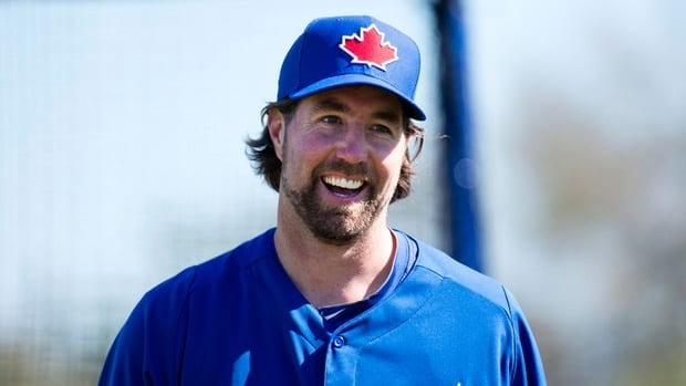 Toronto Blue Jays starting pitcher R.A. Dickey smiles after pitching his first live batting practice during baseball spring training in Dunedin, Fla., on Sunday, Feb. 17, 2013.