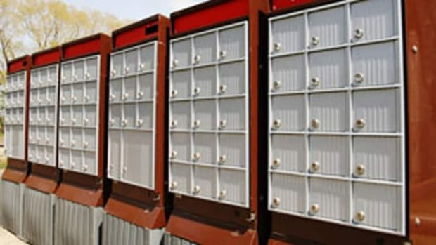 Canada Post will transition from home delivery to community mailboxes over five years. (CBC)