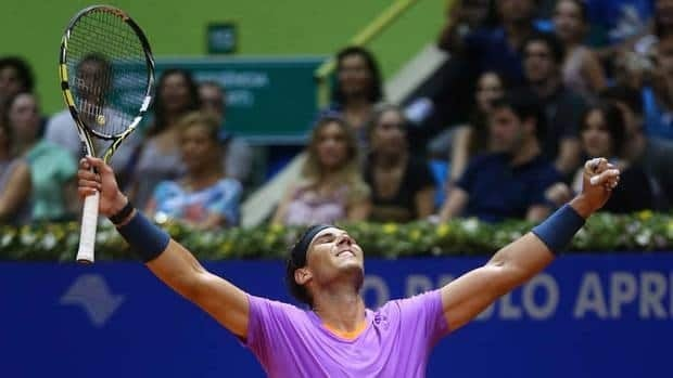 It's been a long road back for Spain's Rafael Nadal, as he celebrates at the end of the Brazil Open ATP tournament final against Argentina's David Nalbandian on Sunday. Nadal has been working back to form after a seven-month layoff.