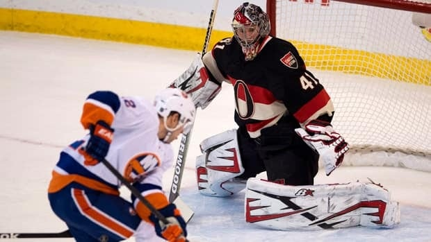 New York Islanders' Josh Bailey shoots against Ottawa Senators goalie Craig Anderson during the first period on Tuesday February 19, 2013.