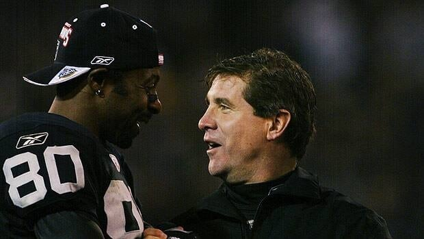 Oakland Raiders coach Bill Callahan and Jerry Rice, seen in the 2003 playoffs just a few weeks before Super Bowl XXXVII, are at odds over the nearly forgotten game.