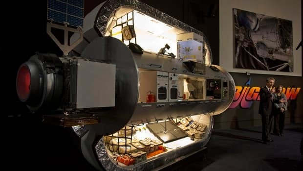 A scaled down version of a module being built by NASA and Bigelow Aerospace is previewed on Wednesday. The inflatable module will be installed at the International Space Station in 2015.