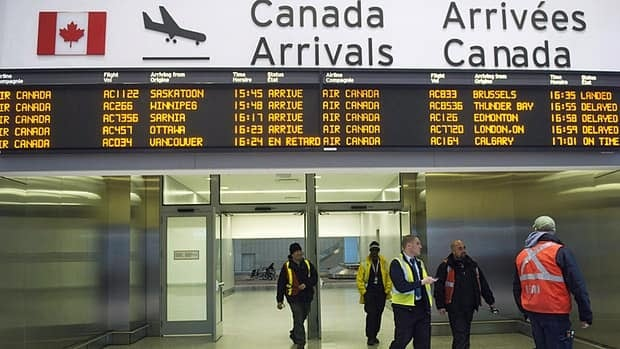 Air Canada workers walk through Pearson International Airport in Toronto on Wednesday.