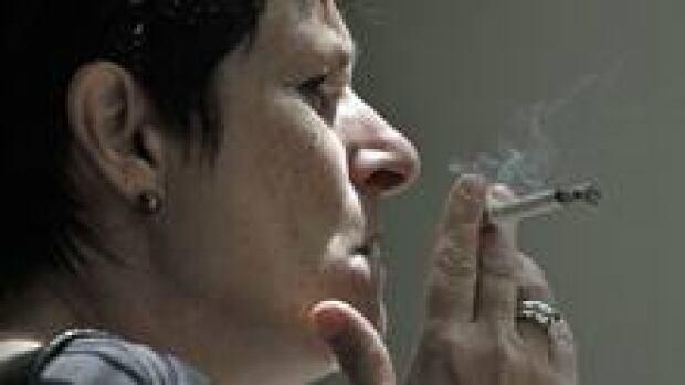 si-smoking-woman-220-cp-rtr
