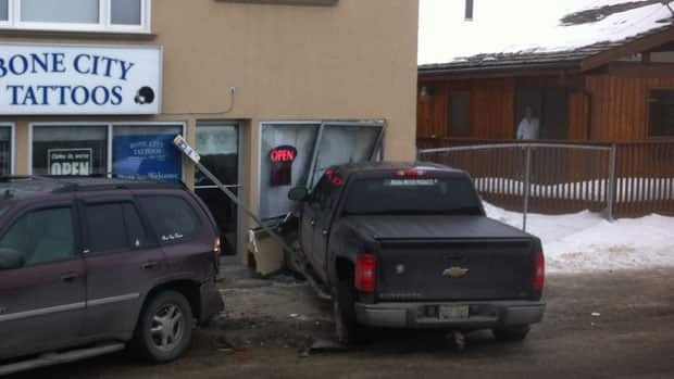 A truck, hit by another vehicle, ended up smashing into the front of this tattoo shop in Regina.
