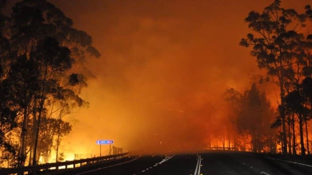 A wildfire in Australia crosses the Princes Highway on Tuesday. No deaths related to the fires have been reported in the country.