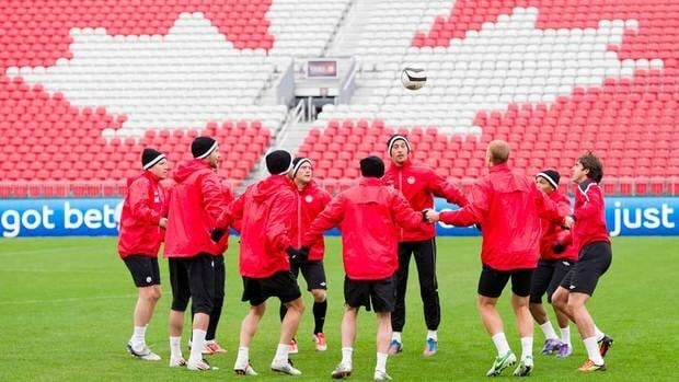 Members of Canada's national men's soccer team, that will now be guided by Colin Miller, practice last fall in Toronto.