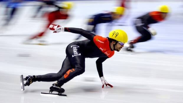 Charles Hamelin, of Sainte-Julie, Que., races to a silver medal in the men's 5,000-metre relay final at the ISU World Cup short track speed skating event in Calgary on Sunday.