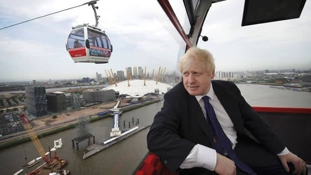London Mayor Boris Johnson rides the Airline cable car that links North Greenwich Peninsula and the Albert Docks in east London on June 27.