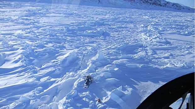 Burton Winters' abandoned snowmobile photographed from a helicopter over the sea ice outside Makkovik, Labrador.