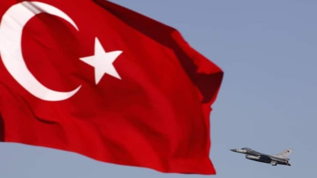 A Turkish air force jet fighter takes off from an air base as Turkey's national flag is seen in the foreground. An air force jet from Turkey went down in Syrian waters on Friday.
