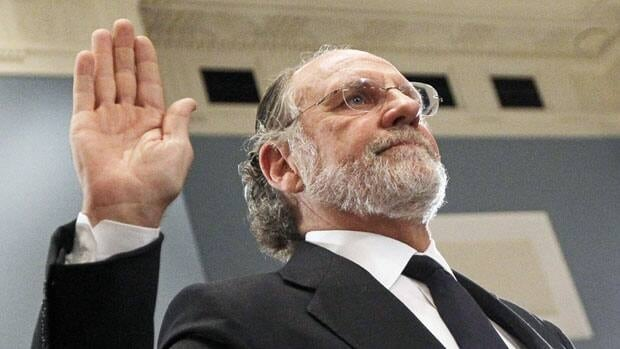 Former U.S. Senator Jon Corzine is sworn in at a Congressional hearing on the collapse of his former company.