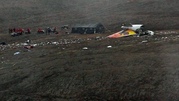 Investigators work at the scene of the First Air crash site in Resolute, Nunavut, in August 2011.