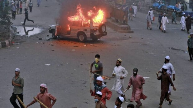 Bangladeshi activists from Hefatjat-e-Islam, a newly formed group, set a police jeep on fire during a protest in Dhaka, Bangladesh, Sunday, May 5, 2013. Police in Bangladesh's capital fired rubber bullets to disperse stone-throwing Islamic activists Sunday during a protest to demand that the government enact an anti-blasphemy law.