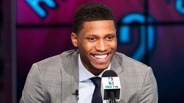 Toronto Raptors newly acquired forward Rudy Gay laughs while speaking to the media during a press conference on Friday.