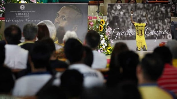 "Mexico's club America fans and relatives of Ecuador striker Christian ""Chucho"" Benitez take part in a mass for Benitez's death in Mexico City. Benitez died in Qatar on Monday of heart failure at the age of 27. He played 58 times for Ecuador and joined his Qatari club El Jaish from Mexico's America."