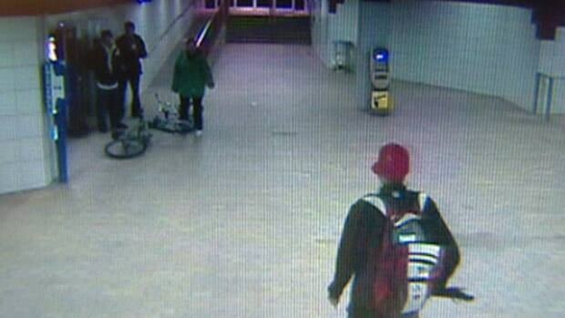 A still from surveillance video taken at the Stadium LRT station shows a man in a red ball cap having a confrontation with Heather Thurier and two companions moments before she was shot.