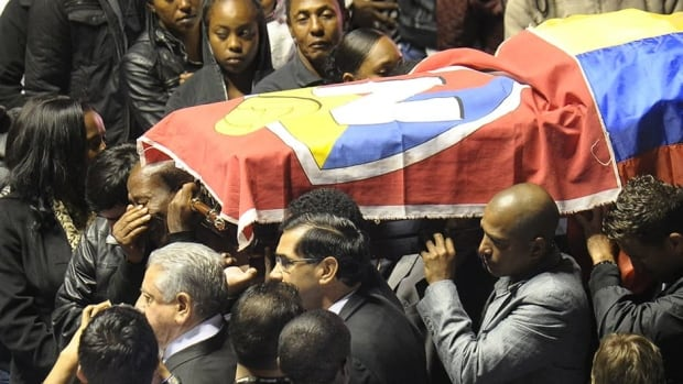 Relatives and colleagues of deceased Ecuadorean footballer Christian Benitez carry his coffin during his funeral in Quito on Friday. Benitez died suddenly in Qatar on Monday at the age of 27.