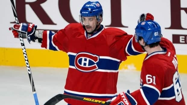Montreal Canadiens centre Tomas Plekanec, left, celebrates with Raphael Diaz after scoring the fourth goal against the Winnipeg Jets on Tuesday, January 29, 2013 in Montreal.