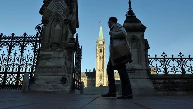 A man makes his way toward Parliament Hill next to the wrought-iron Queen's gate on Monday, Sept. 19, 2011. A plan to improve Hill security will see retractable barriers installed at the gate's vehicle entrance.