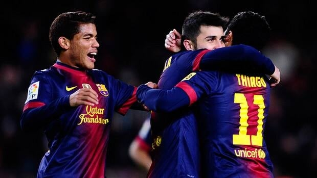 FC Barcelona's David Villa, centre, celebrates after scoring against Alaves during a Copa del Rey soccer match at the Camp Nou stadium in Barcelona, Spain on Wednesday.