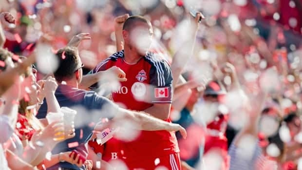 Toronto FC 's Danny Koevermans celebrates his game-winning goal against Philadelphia Union with fans amid ticker tape during the second half in Toronto on Saturday.