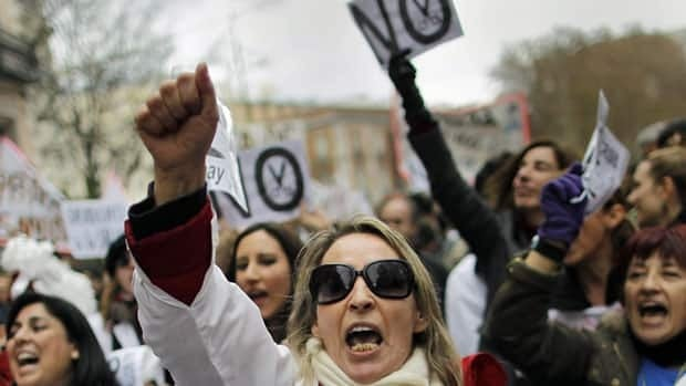 Demonstrators protest earlier this month in Madrid against austerity in health care services. Spain, with 25 per cent unemployment, is in its second recession in three years.