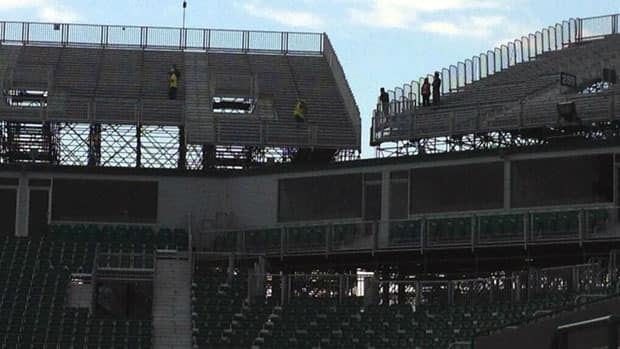Workers are examining the state of some temporary seats at Mosaic Stadium in Regina following an intense hail storm.