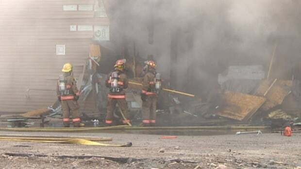 The former A.J. Walker & Son hardware store was badly damaged by fire on Thursday.