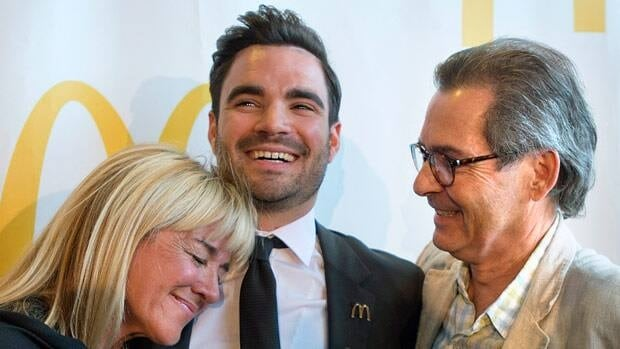 Canadian diver Alexandre Despatie is hugged by his parents Christiane and Pierre following Tuesday's news conference.