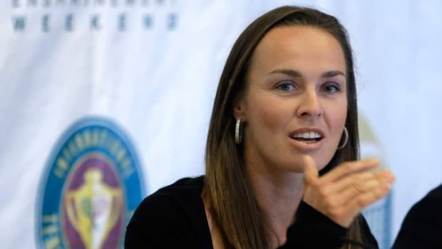 Tennis great Martina Hingis, of Switzerland, speaks during a news conference prior to her enshrinement into the International Tennis Hall of Fame in Newport, R.I., on Saturday.