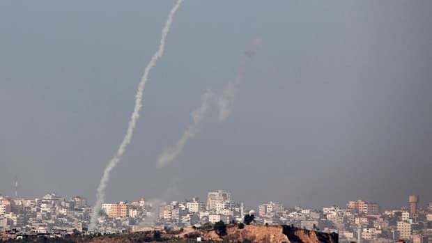 A rocket launched toward Israel leaves a trail of smoke over the northern Gaza Strip.