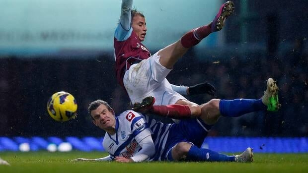 West Ham United's Marouane Chamakh, top, competes for the ball with QPR's Ryan Nelsen during the English Premier League match in London, Saturday, July 19, 2013.