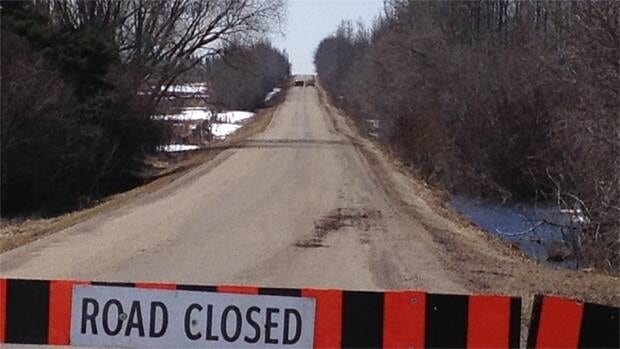 Edmonton police block off a road where a body was discovered Wednesday morning.