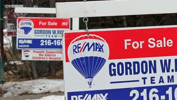 For sale signs shown in Calgary in March. The Royal Bank hiked five-year mortgage rates Monday.