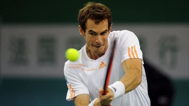 Andy Murray hits a return to Roger Federer in their sem-final match Saturday at the Shanghai Masters.