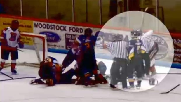 An image from video shows the altercation during a midget A hockey game that has prompted police in Woodstock, Ont., to lay an assault charge against a teenage player.