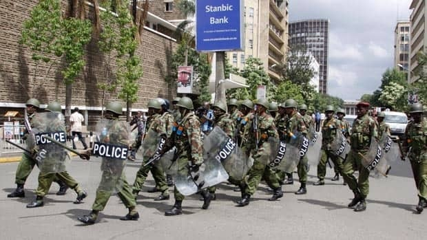 Police patrol near the Supreme Court in Nairobi as the party of Kenya's Prime Minister Raila Odinga files a case with the court over what the claim is massive fraud that took place during the country's March 4 election.