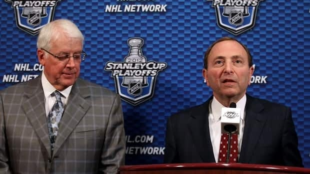 NHL Commissioner Gary Bettman, right, speaks at a press conference to discuss the potential sale of the Phoenix Coyotes to Greg Jamison, left, former CEO of the San Jose Sharks, on Monday.