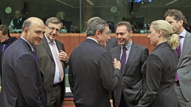 From left, France's Pierre Moscovici, Belgium's Steven Vanackere, European Central Bank President Mario Draghi, European Economic and Monetary Affairs Commissioner Olli Rehn, Greece's Yannis Stournaras and Finland's Jutta Urpilainen gather at a Eurogroup finance ministers' meeting in Brussels Tuesday.